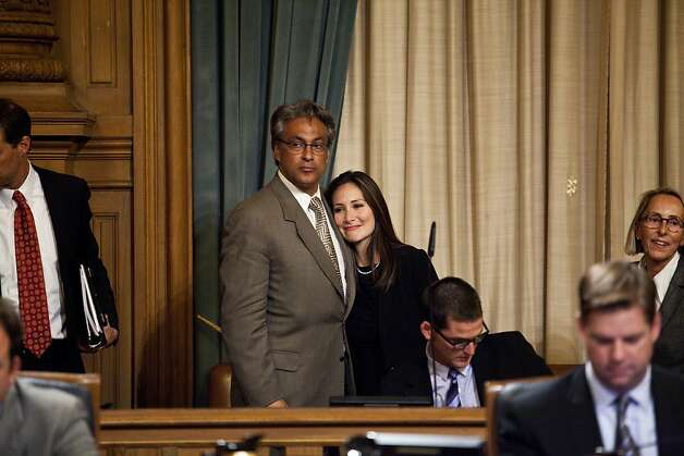 Ross Mirkarimi and wife Eliana Lopez in the supervisors' chambers embrace after they learn that he would be reinstated and keep his job as sheriff. Photo: Jason Henry, Special To The Chronicle