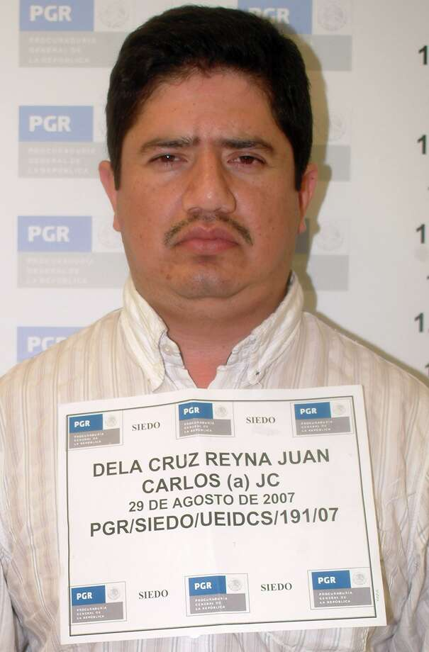 In this picture provided by the Mexican Attorney General's Office in Mexico City, Tuesday, Aug. 29, 2007, Juan Carlos de La Cruz Reyna is seen in an undated photo. The alleged high-ranking Gulf drug cartel member wanted in Texas for threatening to kill U.S. federal agents was seized along with six others in a raid on a steak house in Mexico City, federal prosecutors confirmed Wednesday. (AP Photo/Mexico Attorney General's Office) **  NO SALES  ** Photo: Anonymous, ASSOCIATED PRESS / AP2006
