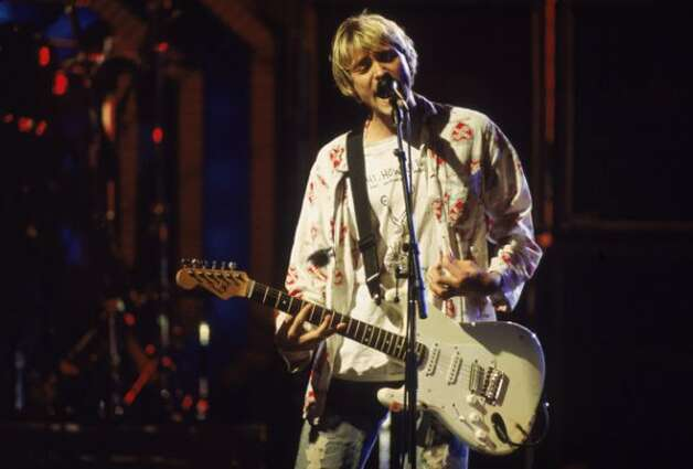 Kurt Cobain (1967 - 1994) performs on stage with Nirvana at the MTV Video Music Awards, September 10, 1992.  (Frank Micelotta / Getty Images)