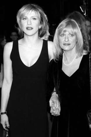 "Courtney Love (L) arrives with her mother-in-law Wendy Cobain, the mother of rock musician Kurt Cobain, who committed suicide in 1994, at the 02 December premiere of ""The People Vs. Larry Flynt"" in Westwood, California. (VINCE BUCCI / AFP/Getty Images)"