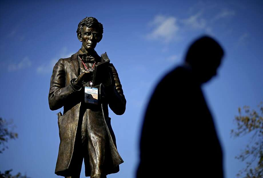 A personalized Abraham Lincoln credential  for Thursday's vice presidential debate hangs on a statue of Lincoln, Wednesday, Oct. 10, 2012, at Centre College in Danville, Ky. Photo: David Goldman, Associated Press