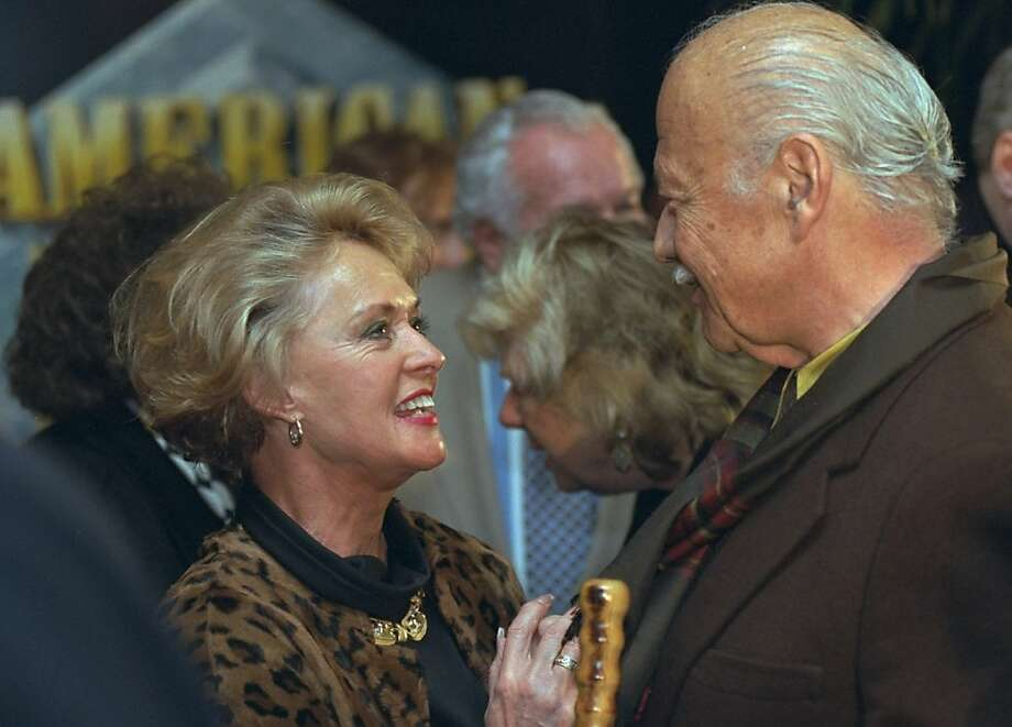 Actors Tippi Hedren and Turhan Bey at a Hollywood screening. Photo: Chris Pizzello, Associated Press