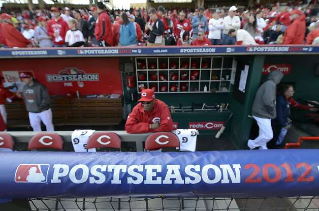 Cincinnati Reds manager Dusty Baker sits in the dugout prior to Game 4 of the National League division baseball series against the San Francisco Giants, Wednesday, Oct. 10, 2012, in Cincinnati. (AP Photo/Michael Keating) Photo: Michael Keating, Associated Press