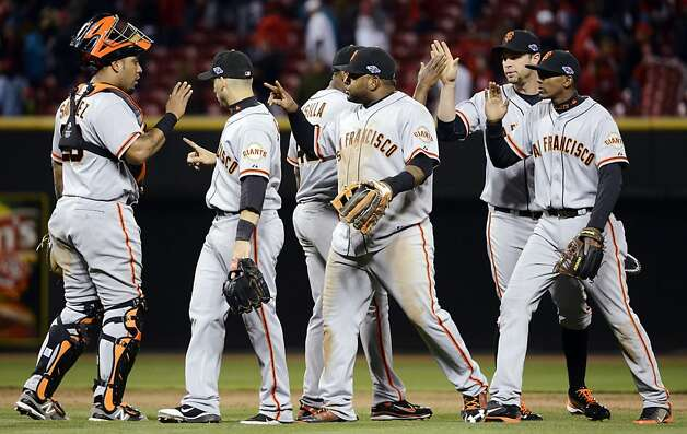 San Francisco Giants players celebrate after defeating the Cincinnati Reds 8-3 in Game 4 of the National League division baseball series, Wednesday, Oct. 10, 2012, in Cincinnati. (AP Photo/Michael Keating) Photo: Michael Keating, Associated Press