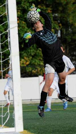 Westhill high school goalie Michael Iafrate stops a shot on goal in a boys soccer game against Greenwich high school played at Westhill high school, Stamford, CT on Wednesday October 10th, 2012. Photo: Mark Conrad / Stamford Advocate Freelance
