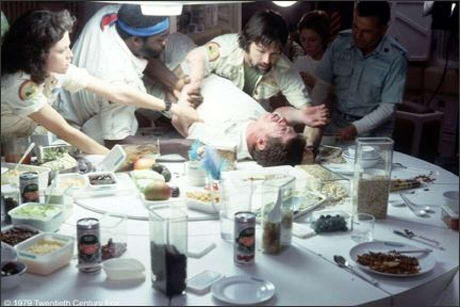 """20. """"Alien""""(1979):   Reviews were mixed when this sci-fi movie came out, but 33 years later, the bloody chestburst dinner scene still ranks as one of the best alien horror moments ever. Photo: 20th Century Fox"""