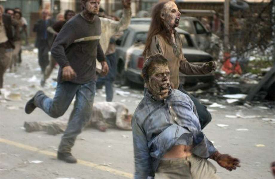 """2. """"Dawn of the Dead""""(2004):    This kinetic remake of the 1978 classic cranked up the speed with zombies who were surprisingly agile, given their decomposed state. The original featured slower creatures, but both films are gory and menacing.  Photo: Universal Studios"""