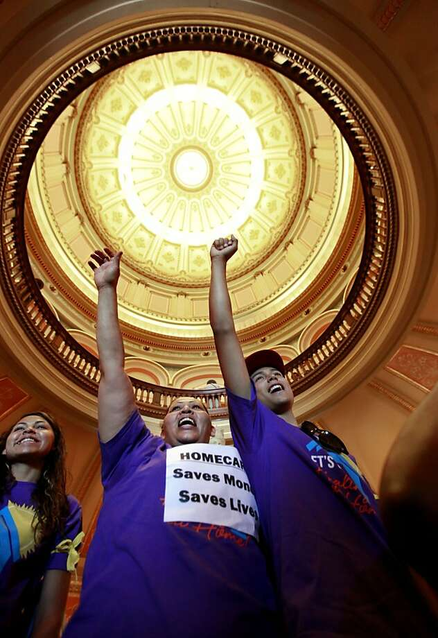 At a rally in the state Capitol in June, demonstrators protest proposed social services budget cuts. Photo: Rich Pedroncelli, Associated Press