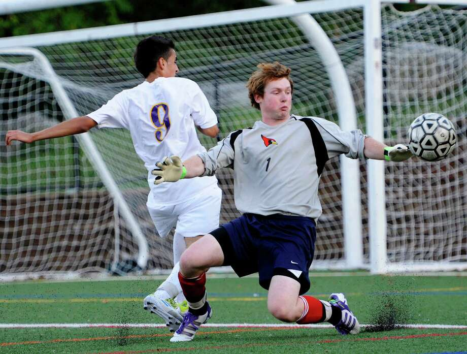 Greenwich high school goalie Emmett Clarke and Westhill high school's Stephen Rozo go after a loose ball in front of the Greenwich goal in a boys soccer game played at Westhill high school, Stamford, CT on Wednesday October 10th, 2012. Photo: Mark Conrad / Stamford Advocate Freelance