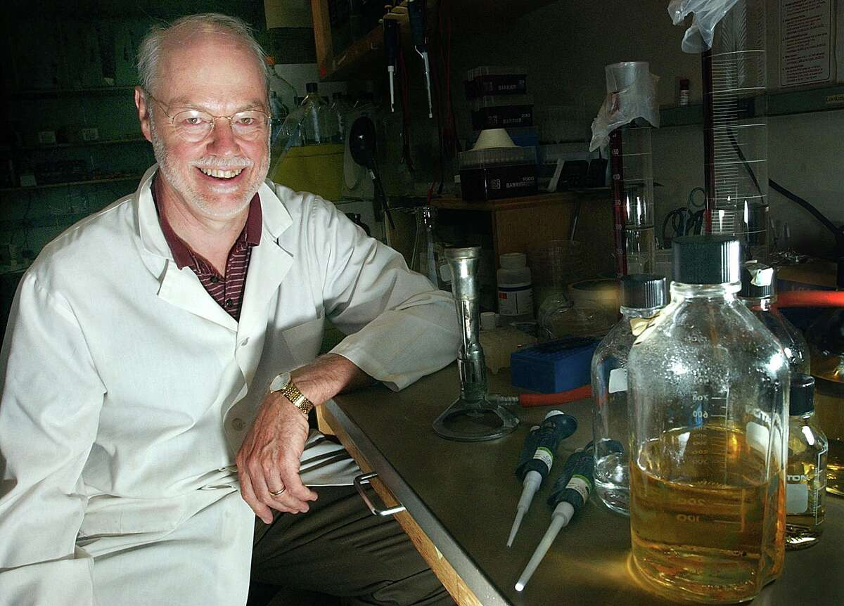 Dr. Phillip A. Sharp, a professor at Massachusetts Institute of Technology, is seen in his laboratory at the Center for Cancer Research at MIT in Cambridge, Mass., Wednesday, July 16, 2003. Sharp said the emerging field of RNA interference has changed his research. The process, discovered by scientists in recent years, uses double stranded RNA to silence genes, which could help quash the effects of destructive genes behind cancer and other diseases. (AP Photo/Chitose Suzuki)