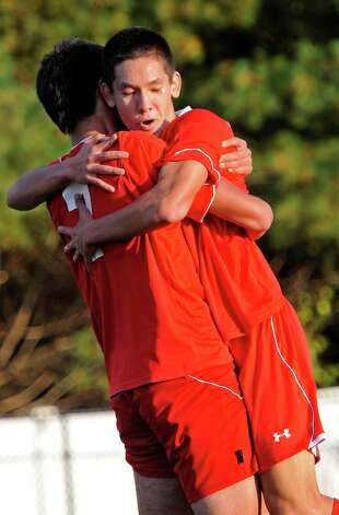 Greenwich high school's Pieter Zenner (right) congratulates teammate Diego Gutierrez after Diego scored a goal in a boys soccer game against Westhill high school played at Westhill high school, Stamford, CT on Wednesday October 10th, 2012. Photo: Mark Conrad / Stamford Advocate Freelance