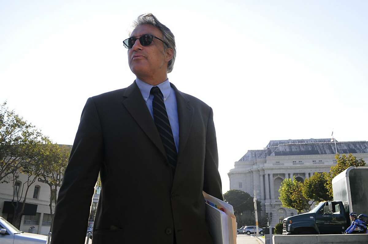 Sheriff Ross Mirkarimi stops to greet a passer-by as he leaves City Hall Wednesday, Oct. 10, 2012, a day after he was reinstated to his position by the board of supervisors.