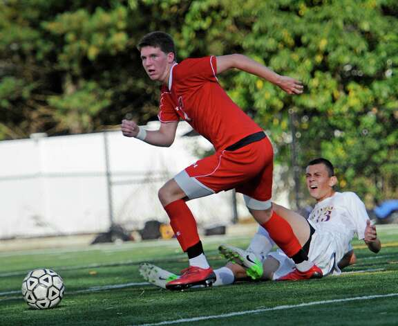 Greenwich high school's Will Gittings gets past Westhill high school's Ian Zacharewicz in a boys soccer game played at Westhill high school, Stamford, CT on Wednesday October 10th, 2012. Photo: Mark Conrad / Stamford Advocate Freelance