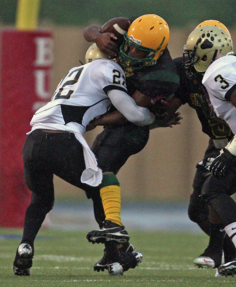 North Forest's Jarvis Harris gives Sharpstown's Jerrod Taylor the kind of rough treatment the Bulldogs' defense has been dishing out all season. North Forest (6-0) hasn't given up more than one touchdown in a game. Photo: Eric Christian Smith