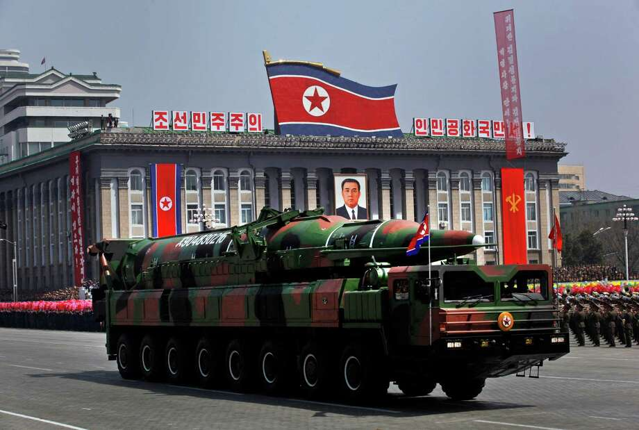 FILE - In this April 15, 2012 file photo, a North Korean vehicle carrying what appears to be a new missile passes by during a mass military parade in the Kim Il Sung Square in Pyongyang to celebrate 100 years since the birth of the late North Korean founder Kim Il Sung. North Korea warned Tuesday, Oct. 9, 2012 that the U.S. mainland is within range of its missiles, saying Washington's recent agreement to let Seoul possess missiles capable of hitting all of the North shows the allies are plotting to invade the country. (AP Photo/Vincent Yu, File) Photo: Vincent Yu