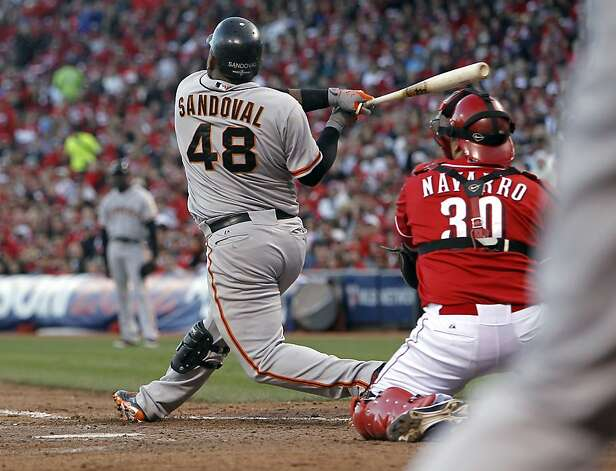 Giants' Pablo Sandoval watches his two run in the seventh inng,  as the San Francisco Giants go on to beat the Cincinnati Reds 8-3, in game four of the National League Division Series in Cincinnati, Ohio on Wednesday Oct. 10, 2012. Photo: Michael Macor, The Chronicle