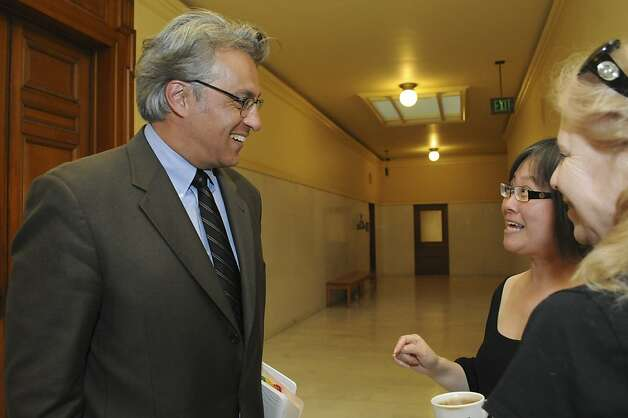 Reinstated Sheriff Ross Mirkarimi greets City Hall employees outside of his office Wednesday, Oct. 10, 2012. Photo: Erik Verduzco, Special To The Chronicle