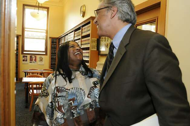 Reinstated Sheriff Ross Mirkarimi greets Karla Guillory, senior legal clerk, in his office Wednesday, Oct. 10, 2012. Photo: Erik Verduzco, Special To The Chronicle