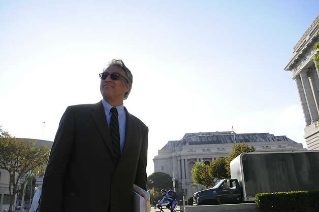 Sheriff Ross Mirkarimi stops to greet a passer-by as he leaves City Hall Wednesday, Oct. 10, 2012, a day after he was reinstated to his position by the board of supervisors. Photo: Erik Verduzco, Special To The Chronicle