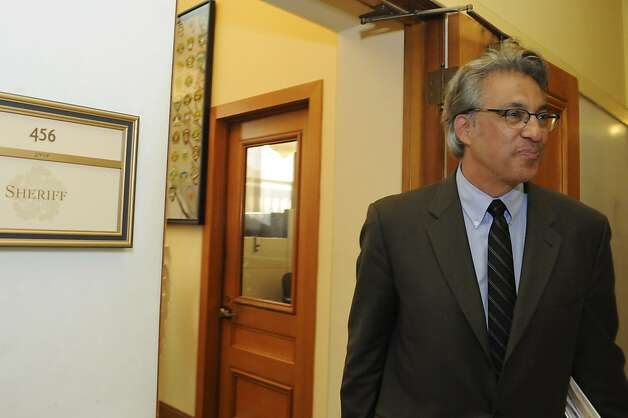 Sheriff Ross Mirkarimi leaves his office Wednesday, Oct. 10, 2012, a day after he was reinstated to his position by the board of supervisors. Photo: Erik Verduzco, Special To The Chronicle