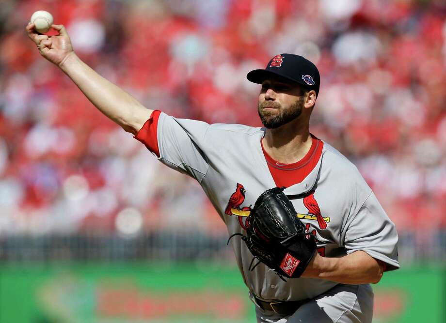 St. Louis Cardinals starting pitcher Chris Carpenter throws against the Washington Nationals in the first inning of Game 3 of the National League division baseball series on Wednesday, Oct. 10, 2012, in Washington. (AP Photo/Alex Brandon) Photo: Alex Brandon