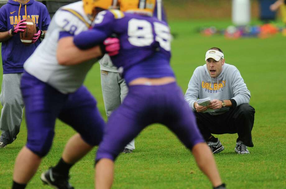 UAlbany offensive coordinator Ryan McCarthy, who was elevated to associate head coach this season,  watches practice on Wednesday Oct. 10, 2012 in Albany, NY.    (Philip Kamrass /  Times Union) Photo: Philip Kamrass / 00019598A