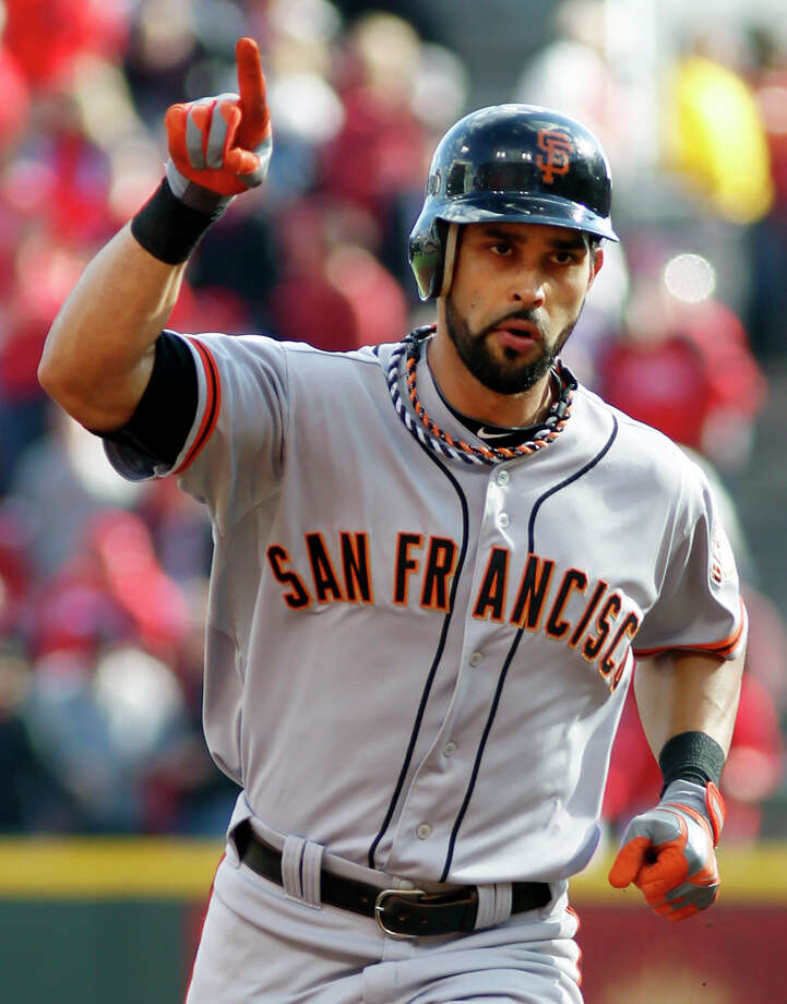 San Francisco Giants' Angel Pagan gestures as he rounds the bases after hitting a solo home run against the Cincinnati Reds in the first inning of Game 4 of the National League division baseball series, Wednesday, Oct. 10, 2012, in Cincinnati. (AP Photo/David Kohl) Photo: David Kohl