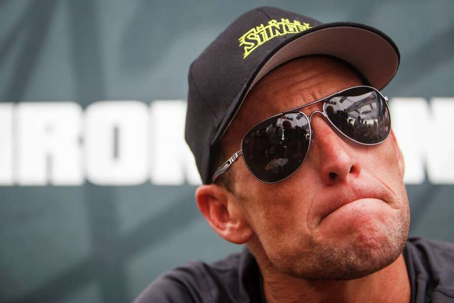 FILE - This April 1, 2012 file photo shows seven-time Tour de France champion Lance Armstrong grimacing during a news conference after the Memorial Hermann Ironman 70.3 Texas triathlon in Galveston, Texas. The world may soon know what the U.S. Anti-Doping Agency has on Armstrong. USADA has said it had 10 former teammates ready to testify against Armstrong before he chose not to take his case to an arbitration hearing. The list likely includes previous Armstrong accusers Floyd Landis and Tyler Hamilton. (AP Photo/Houston Chronicle, Michael Paulsen, File ) MANDATORY CREDIT Photo: Michael Paulsen