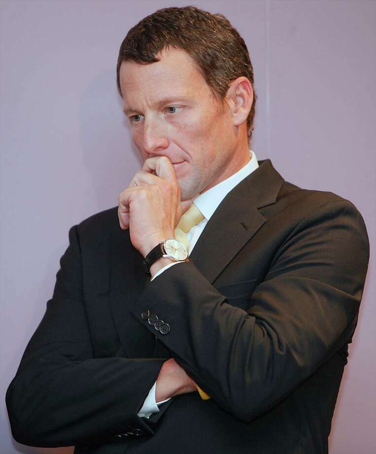 FILE - This Feb. 28, 2011 file photo shows Lance Armstrong listening to a fellow cancer survivor during a news conference in Los Angeles.. The world may soon know what the U.S. Anti-Doping Agency has on Armstrong. USADA has said it had 10 former teammates ready to testify against Armstrong before he chose not to take his case to an arbitration hearing. The list likely includes previous Armstrong accusers Floyd Landis and Tyler Hamilton.  (AP Photo/Damian Dovarganes, File) Photo: Damian Dovarganes