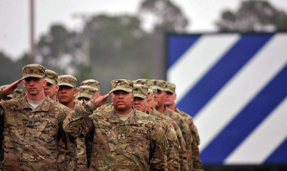 One hundred soldiers from the Army's 1st Battalion, 30th Infantry Regiment salute during the national anthem at a welcome home ceremony, Wednesday, Oct. 10, 2012 at Fort Stewart, Ga. Overall about 2,200 soldiers from Fort Stewart's 3rd Infantry Division have deployed to Afghanistan this year. (AP Photo/Stephen Morton) Photo: Stephen Morton, Associated Press / FR56856 AP