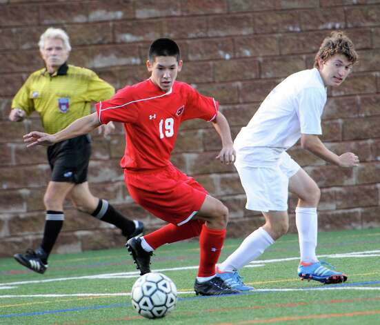 Greenwich high school's Pieter Zenner tries to beat out Westhill's Cory Benz to the ball in a boys soccer game played at Westhill high school, Stamford, CT on Wednesday October 10th, 2012. Photo: Mark Conrad / Stamford Advocate Freelance