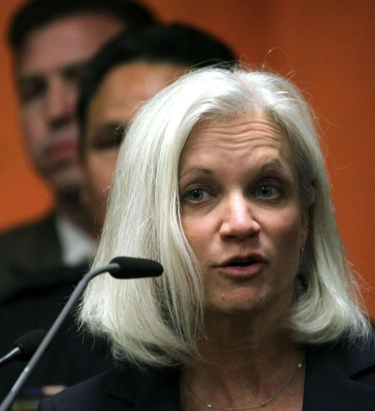 United States Attorney Melinda Haag, stood with Bay Area law enforcement representatives behind her, to announce the arrests of 13 members and associates of the 500 Block/C Street gang during a news conference in South San Francisco, Calif., Thursday, May 3, 2012. Three Immigration and Customs Enforcement agents were shot and injured during one of the raids Thursday is Petaluma Calif.