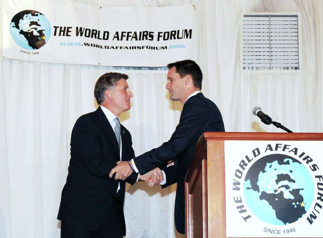 The start of the World Affairs Forum debate between Steve Obsitnik, left, the Republican challenger, who shakes hands with incumbent U.S. Rep. Jim Himes, D-Conn., 4th District, at Hyatt Regency Greenwich, Wednesday night, Oct. 10, 2012. Photo: Bob Luckey / Greenwich Time
