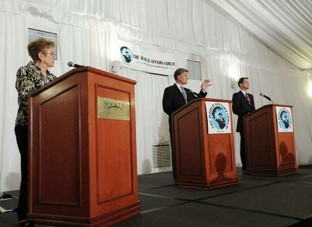 Executive Director of the World Affairs Forum, Kay Maxwell , left, moderates her organization's debate between Steve Obsitnik, center, the Republican challenger, and incumbent U.S. Rep. Jim Himes, D-Conn., 4th District, at Hyatt Regency Greenwich, Wednesday night, Oct. 10, 2012. Photo: Bob Luckey / Greenwich Time