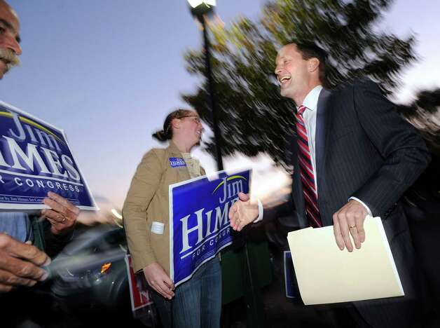 At right, U.S. Rep. Jim Himes, D-Conn., 4th District, shakes hands with supporters prior to the debate against Steve Obsitnik, the Republican challenger, at Hyatt Regency Greenwich, Wednesday night, Oct. 10, 2012. Photo: Bob Luckey / Greenwich Time
