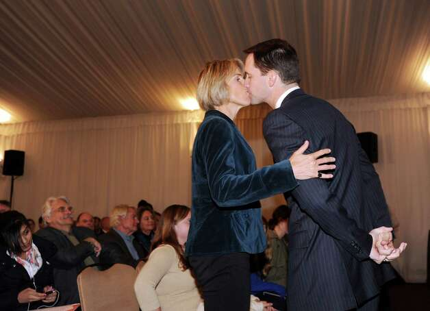 At left, Mary Himes kisses her husband, U.S. Rep. Jim Himes, D-Conn., 4th District, prior to a debate between Himes and Steve Obsitnik, the Republican challenger, at Hyatt Regency Greenwich, Wednesday night, Oct. 10, 2012. Photo: Bob Luckey / Greenwich Time