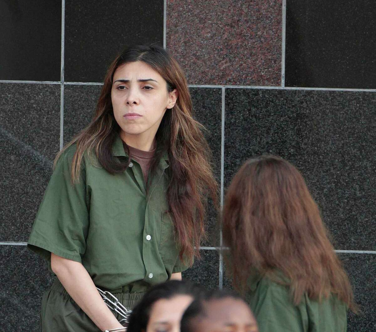 Sevinj Taghiyva is transported from the Bob Casey Federal Courthouse Wednesday, Oct. 10, 2012, in Houston. Taghiyva is one of the women that has been indicted for allegedly being part of a scheme to illicitly funnel military cutting-edge microelectronics to Russia. Alexander Fishenko ran a Houston-based company that obtained highly regulated technology from U.S. makers and clandestinely exported it to Russia for use by that country's military and intelligence agencies. U.S. authorities say the microelectronics could have a wide range of military uses, including radar and surveillance systems, weapons guidance systems and detonation triggers. Prosecutors are seeking to deny bond to Fishenko because they consider him a flight risk. (Billy Smith II / Houston Chronicle)
