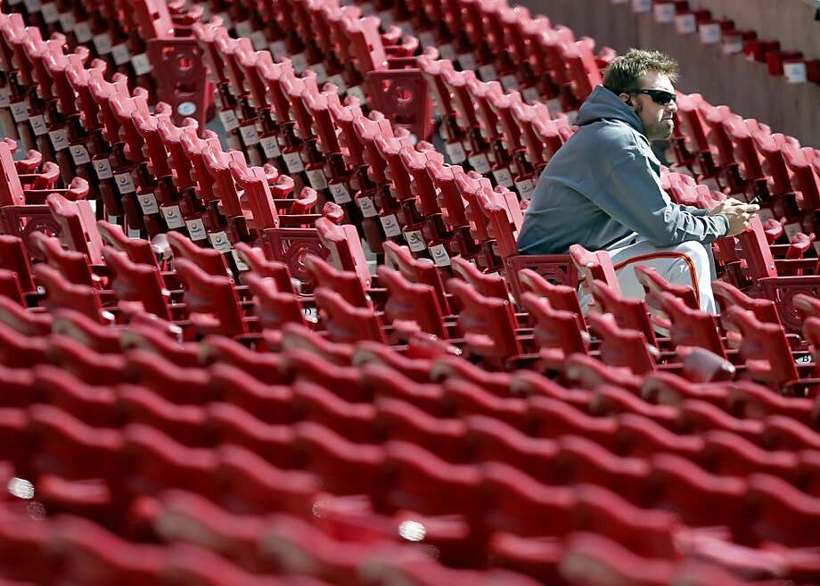 Giants' pitcher, Jeremy Affelt hangs out in the stands hours before the start of the game, as the San Francisco Giants prepare to take on the Cincinnati Reds in game four of the National League Division Series in Cincinnati, Ohio on Wednesday Oct. 10, 2012. Photo: Michael Macor, The Chronicle