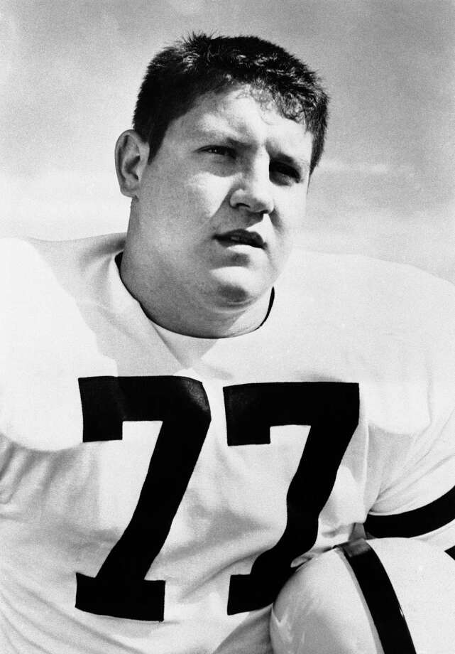 FILE - This 1956 file photo shows Iowa tackle Alex Karras. Karras, who gained fame in the NFL as a fearsome defensive lineman and later as an actor, has died. He was 77. Craig Mitnick, Karras' attorney, said Karras died at home in Los Angeles on Wednesday, Oct. 10, 2012, surrounded by family. (AP Photo, File) Photo: Anonymous