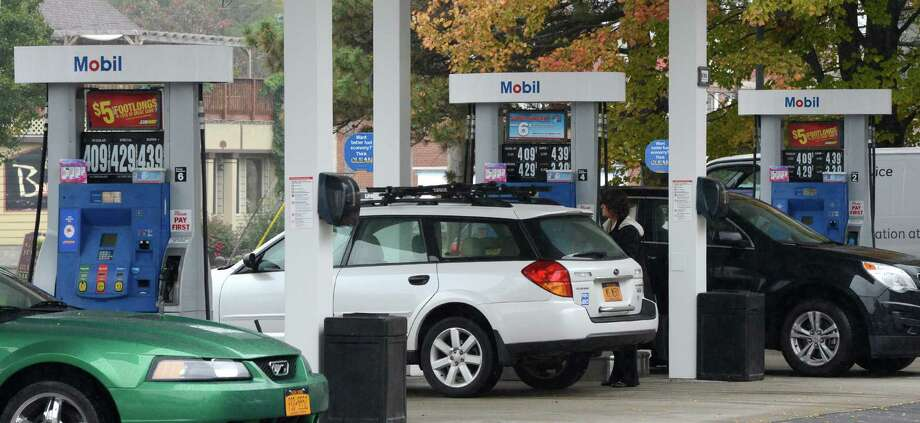 People pump gas at the Mobil Station on Western Avenue near the University at Albany Campus in Albany, N.Y. Oct. 10, 2012.    (Skip Dickstein/Times Union) Photo: Skip Dickstein / 00019611A