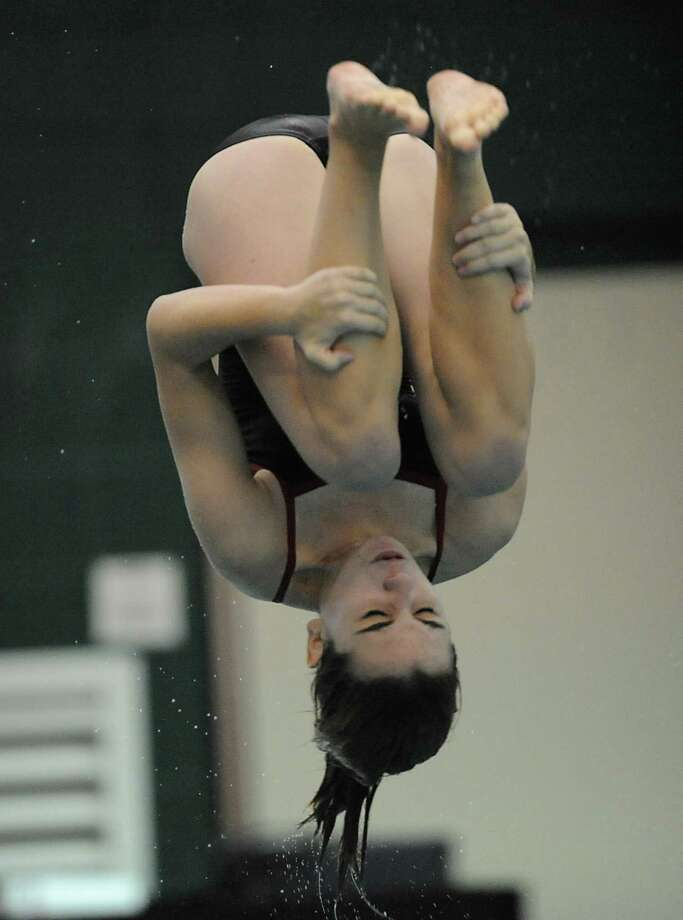 Niskayuna junior Regina Foley performs an inward 1 1/2 dive during a swimming and diving competition with Shenendehowa Wednesday, Oct. 10, 2012 in Clifton Park, N.Y. (Lori Van Buren / Times Union) Photo: Lori Van Buren