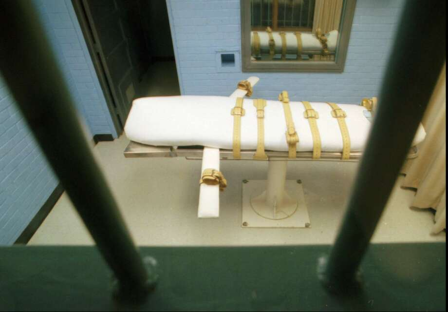 FILE--The death bed is seen through the bars which seperate the death chamber from the witness viewing room at the Walls Unit of the Texas Department of Corrections in Huntsville, Texas, in a Jan. 25, 1995 file photo. New York State has had a death penalty on the books since Sept. 1, 1995 with execution using lethal injection as is done in Texas. Now, Darrel K. Harris, a former prison guard who was convicted of killing three people during a stickup in Brooklyn, N.Y., will be the first inmate to face death by injection since the death penalty was restored in 1995. (AP Photo/David J. Phillip, File) Photo: DAVID J. PHILLIP / AP