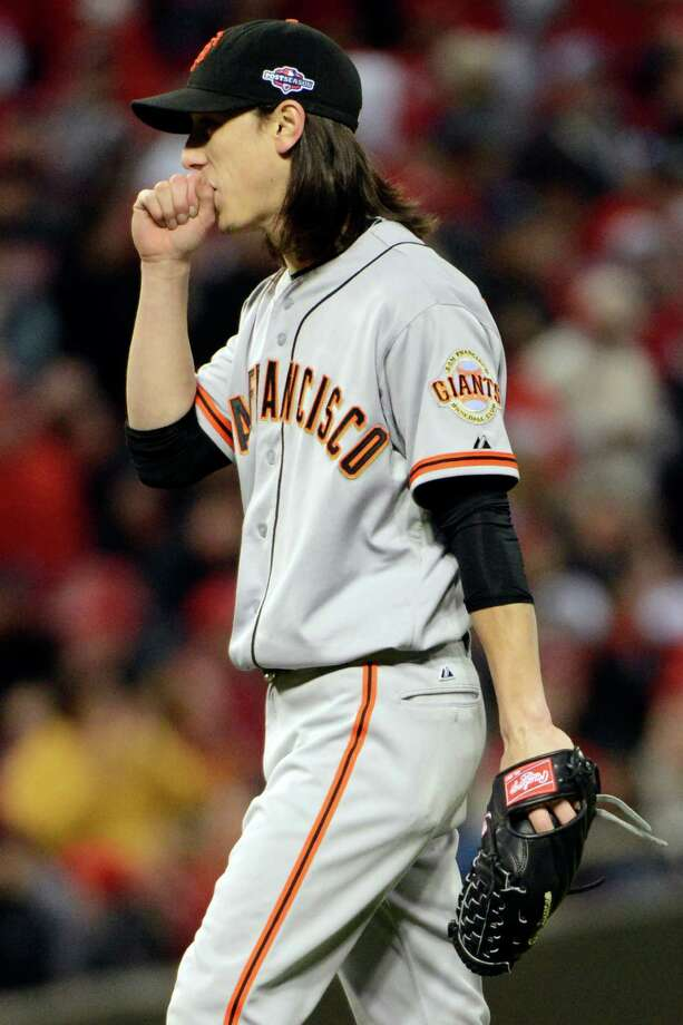 San Francisco Giants relief pitcher Tim Lincecum blows on his hands in the eighth inning of Game 4 of the National League division baseball series against the Cincinnati Reds, Wednesday, Oct. 10, 2012, in Cincinnati. Lincecum was the winning pitcher in the game won by the Giants 8-3. (AP Photo/Michael Keating) Photo: Michael Keating, FRE / FR170759 AP