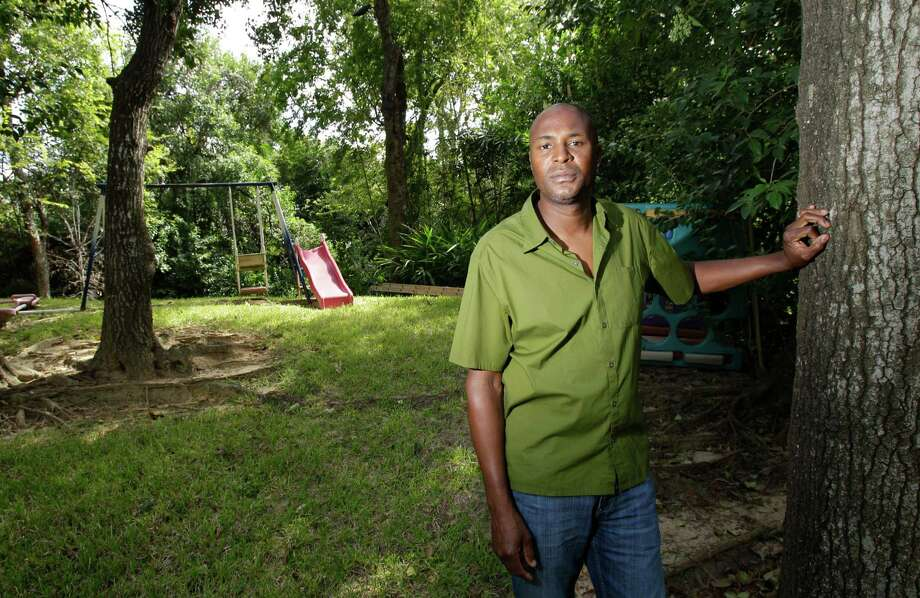 Heights resident and area business owner Gary Mosley says his backyard would no longer be a safe place for his children if a bridge is built right next door to his home. Plans for the condo project have been on and off the books for years. Photo: Melissa Phillip / © 2012 Houston Chronicle