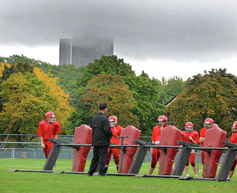 The Corning Tower is barely visible through thick rain clouds as a football team practices at Albany Academy Wednesday, Oct. 10, 2012 in Albany, N.Y. (Lori Van Buren / Times Union) Photo: Lori Van Buren