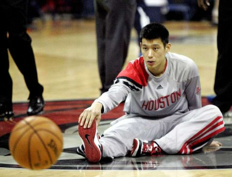 Houston Rockets guard Jeremy Lin stretches before the start of an NBA preseason basketball game agai
