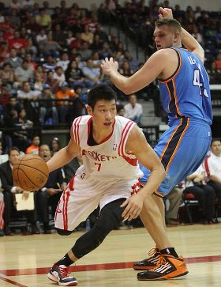 Houston Rockets' Jeremy Lin, left, drives around the baseline against Oklahoma City Thunder defender Cole Aldrich during the first quarter of an NBA preseason basketball game in Hidalgo, Texas, Wednesday, Oct. 10, 2012. (AP Photo/Delcia Lopez) (Associated Press)