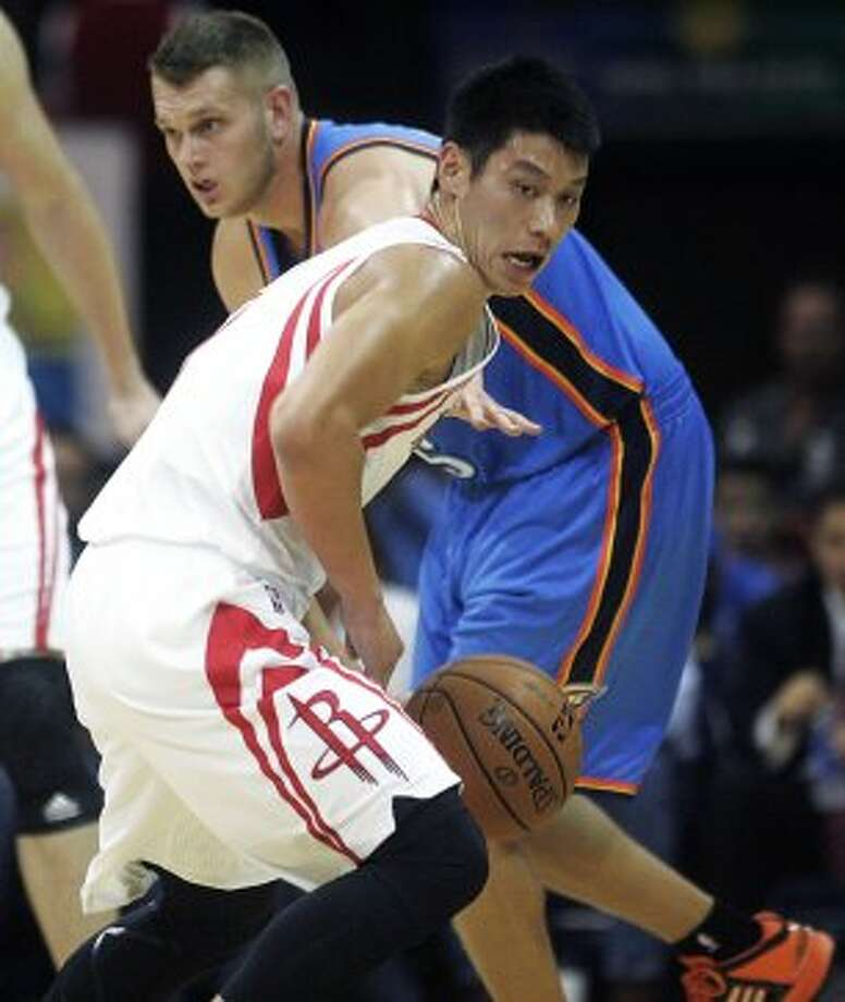 Houston Rockets' Jeremy Lin, left, strips the ball from Oklahoma City Thunders' Cole Aldrich during the first quarter of an NBA preseason basketball game in Hidalgo, Texas, Wednesday, Oct. 10, 2012. (AP Photo/Delcia Lopez) (Associated Press)