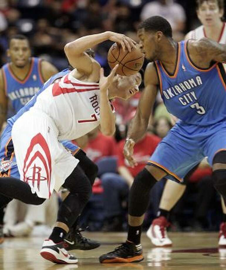 Houston Rockets' Jeremy Lin tries to control ball away from Oklahoma City Thunder defender Perry Jones during the second quarter of an NBA preseason basketball game in Hidalgo, Texas, Wednesday, Oct. 10, 2012. (AP Photo/Delcia Lopez) (Associated Press)