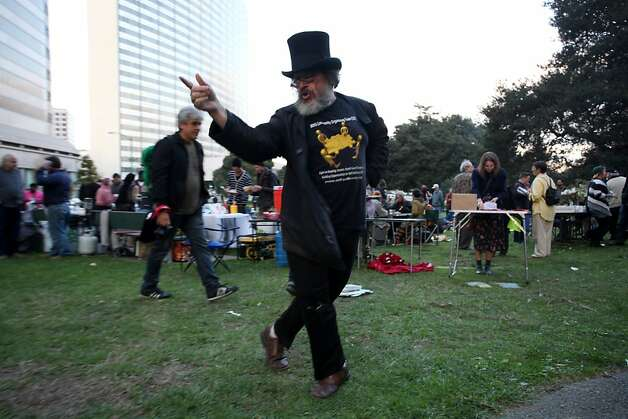 Michael Dihl dances to the music in the park. Occupy Oakland celebrated their 1 year anniversary at Snow Lake in Oakland on Wednesday, October 10, 2012. Photo: Sean Culligan, SFC